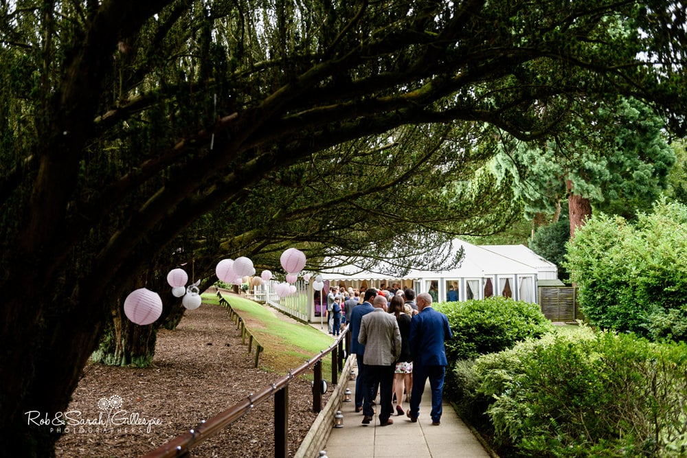Wedding guests enter marquee at New Hall Hotel