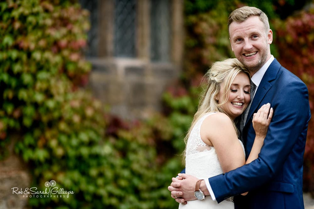Bride and groom together in grounds at New Hall Hotel