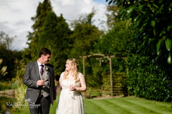 Bride and groom enjoy Redhouse Barn gardens