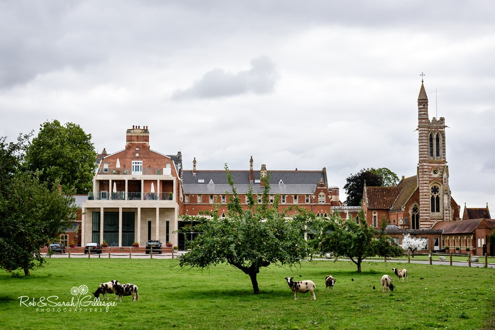 View of Stanbrook Abbey Hotel with trees and goats in foreground