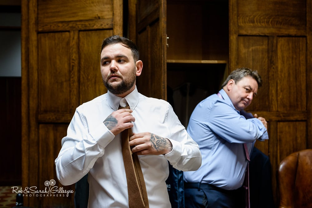 Groom and groomsmen get ready for wedding at Stanbrook Abbey