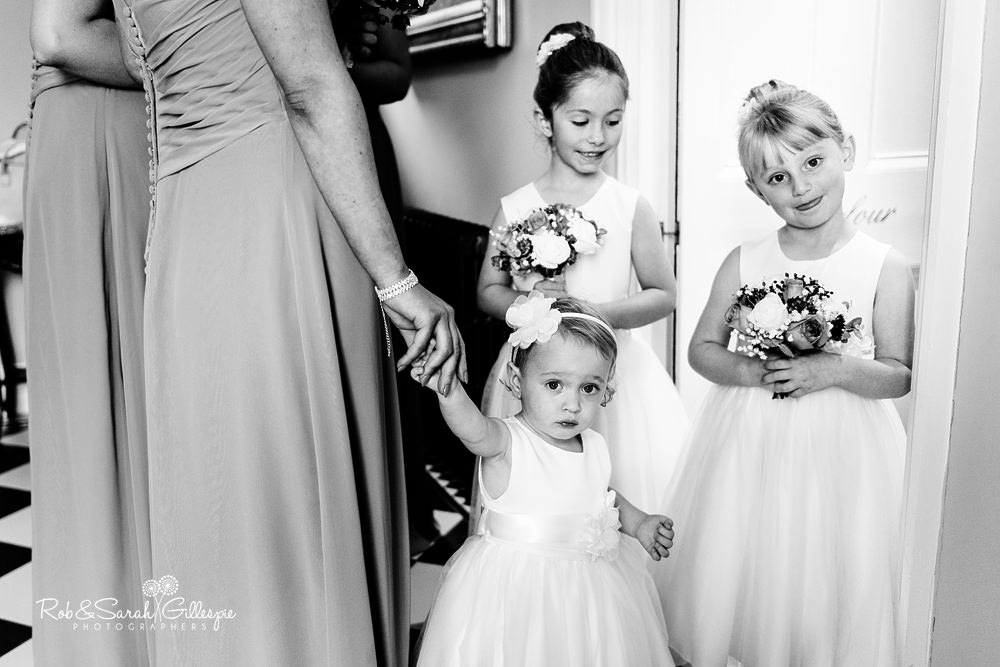 Flower girls pose for photo before wedding at Stanbrook Abbey