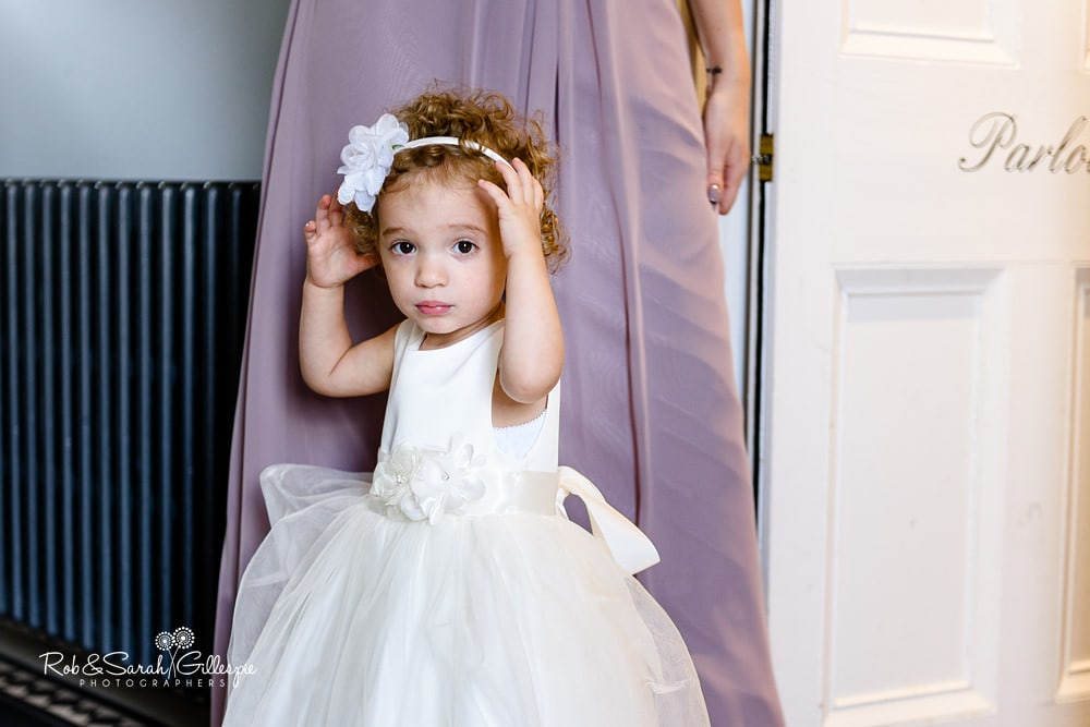 Flower girl poses for photo at Stanbrook Abbey Hotel