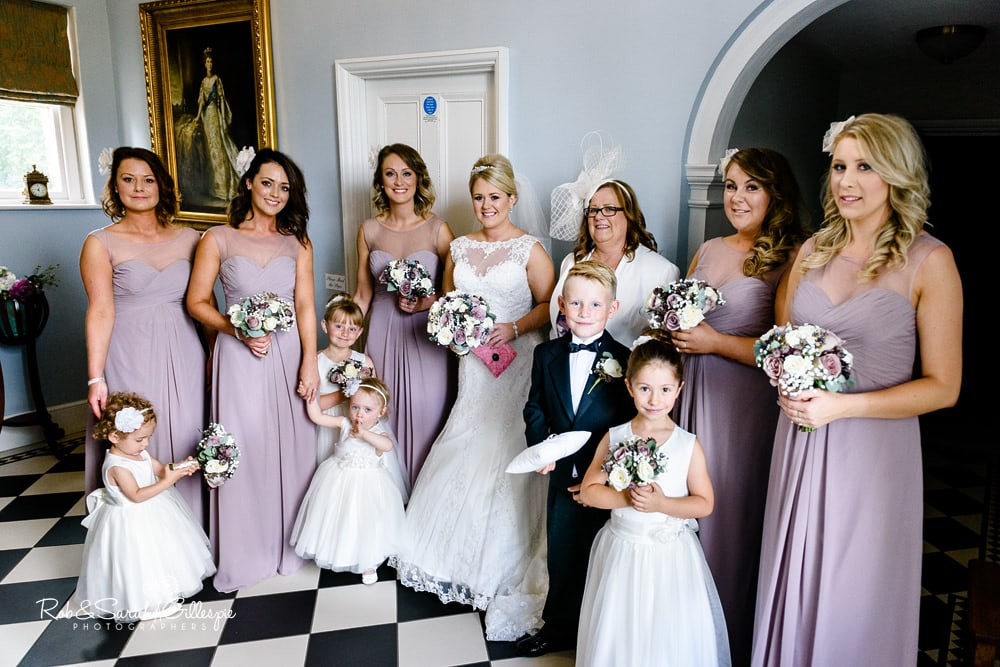 Bride and bridesmaids pose for photo in Brides Manor at Stanbrook Abbey