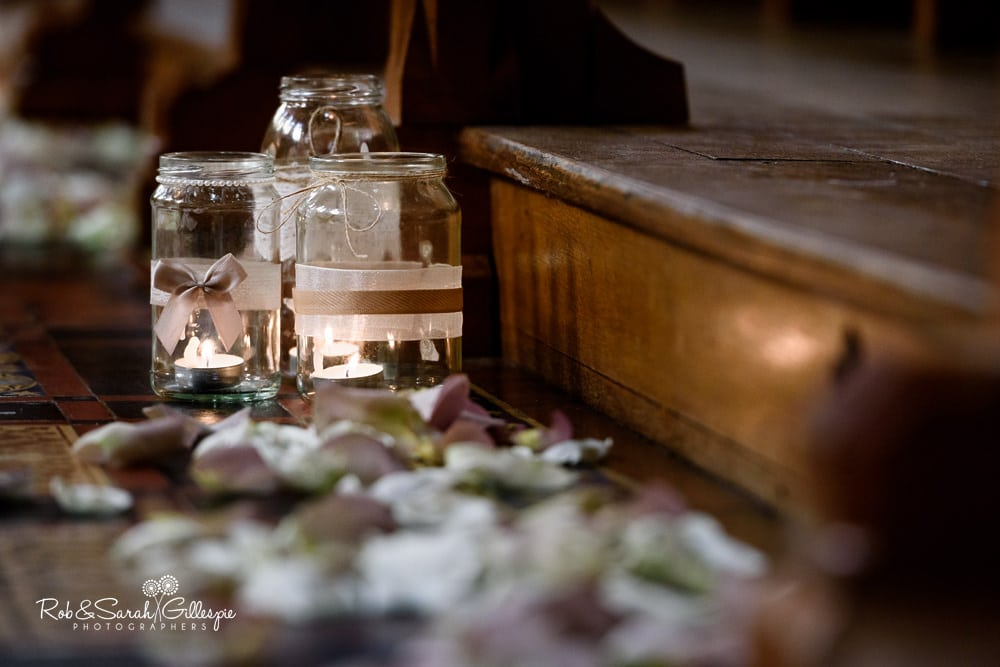 Candles in jars and confetti decorate Callow Hall at Stanbrook Abbey wedding