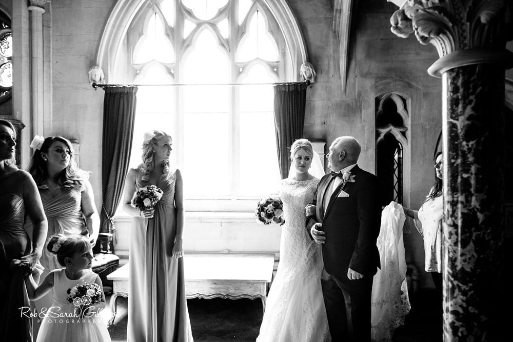 Black and white picture of bride and father just before wedding ceremony at Stanbrook Abbey