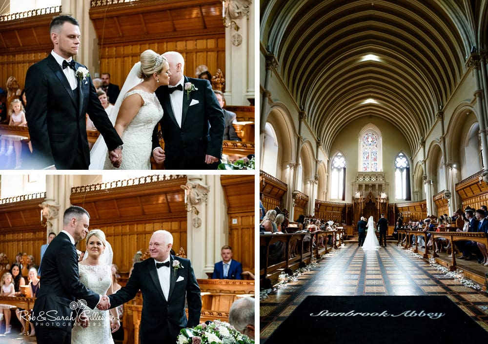 Bride's father kisses daughter and gives her hand to groom at Stanbrook Abbey wedding