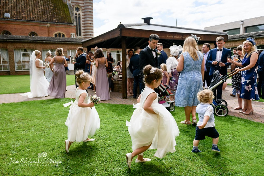Children play during drinks reception at Stanbrook Abbey wedding