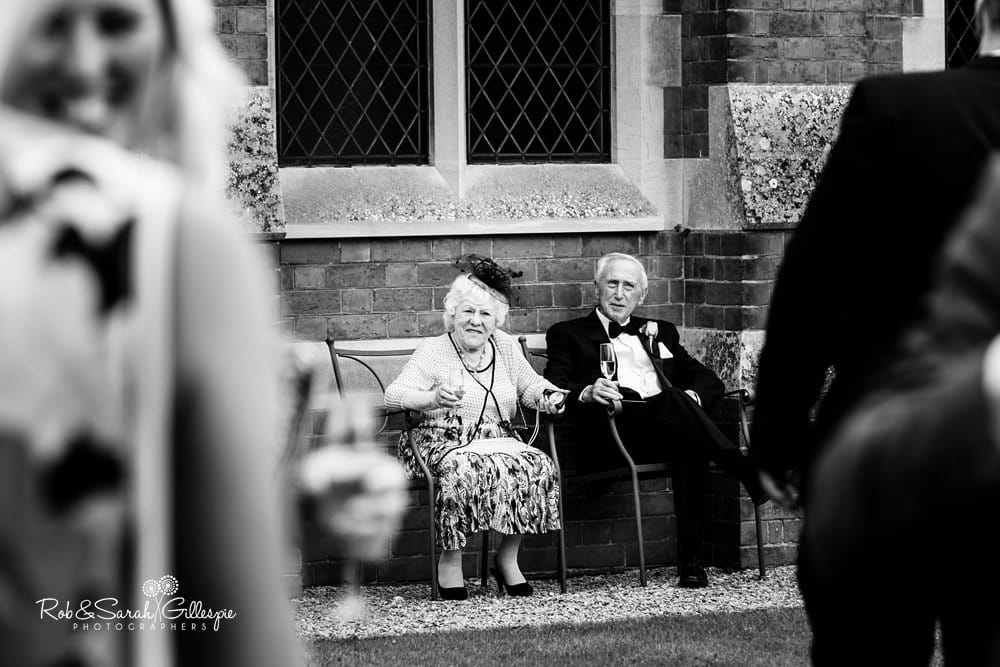 Wedding guests enjoy drinks reception at Stanbrook Abbey wedding