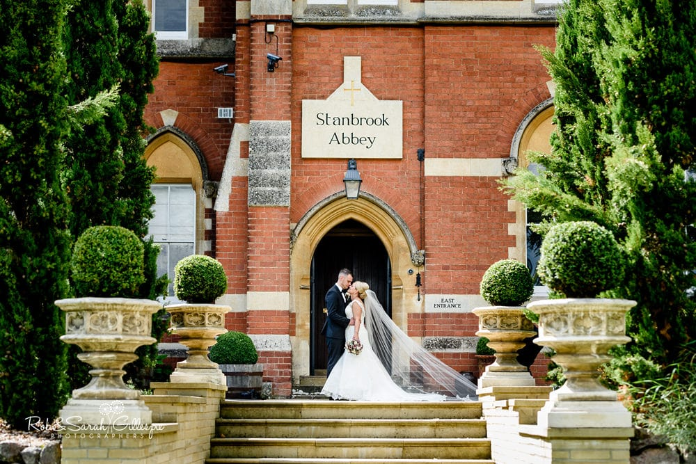 Bride and groom outside Stanbrook Abbey