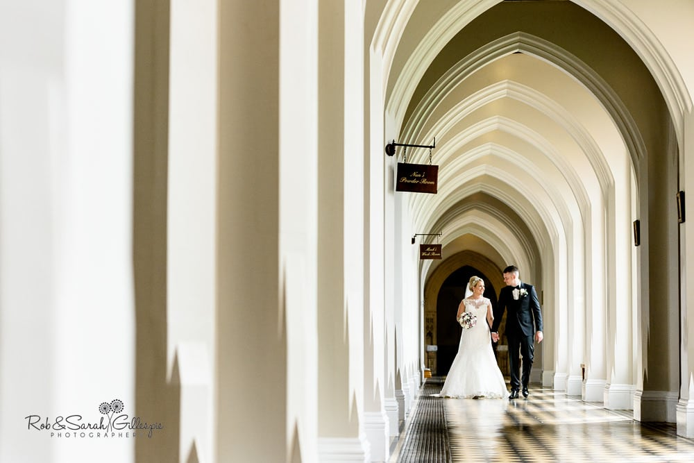 Bride and groom together in cloister corridor at Stanbrook Abbey
