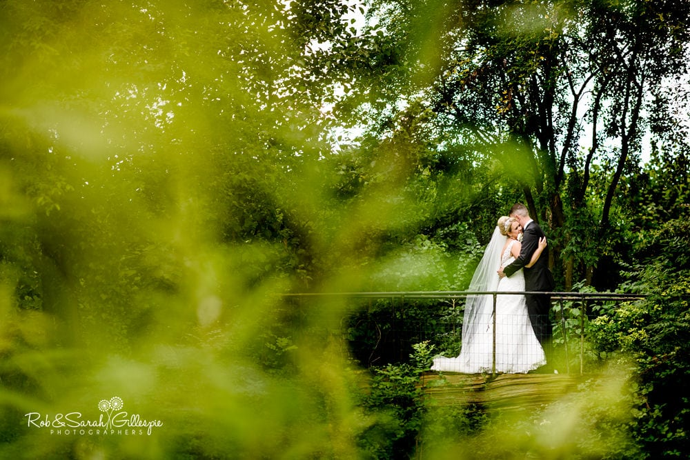 Bride and groom together in grounds at Stanbrook Abbey