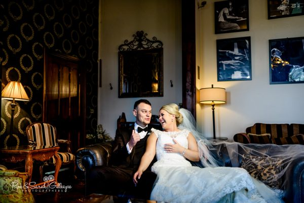 Bride and groom in lounge at Stanbrook Abbey
