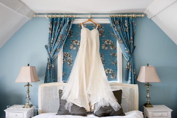 Wedding dress hanging at Stanbrook Abbey