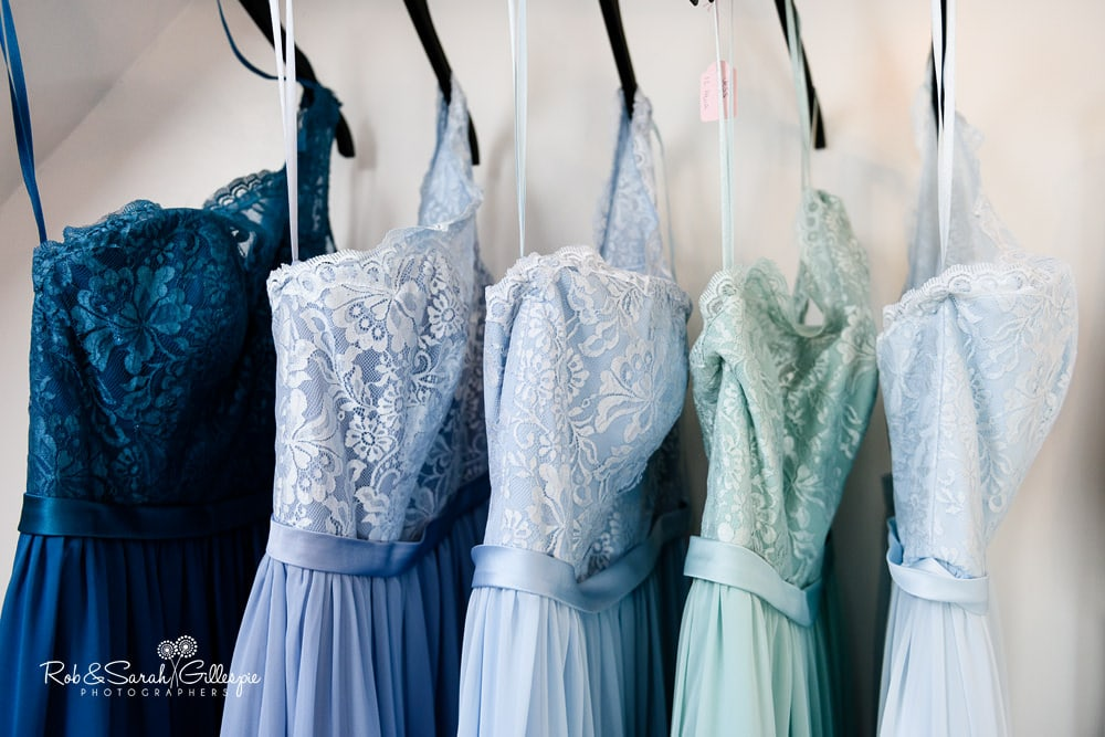 Bridesmaid dresses hanging at Stanbrook Abbey