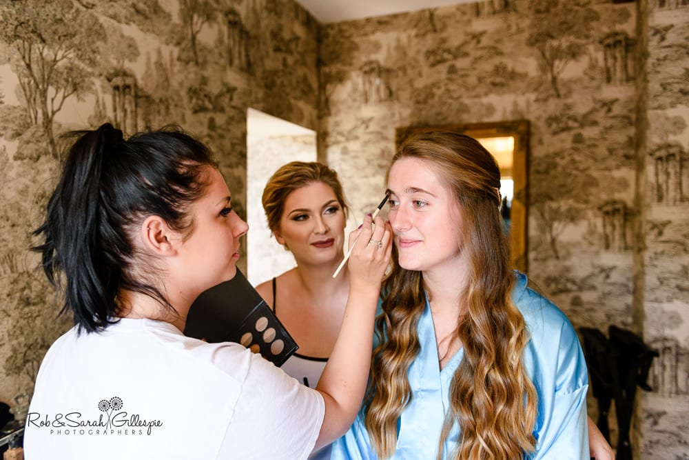Bride and bridesmaids prepare for wedding at Stanbrook Abbey