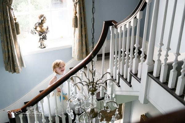 Flowergirl on staircase at Stanbrook Abbey