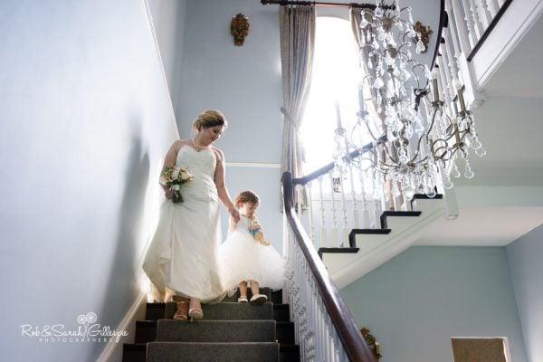 Bride and daughter on Stanbrook Abbey staircase