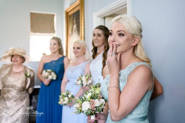 Bridesmaid sheds a tear as she sees bride at Stanbrook Abbey
