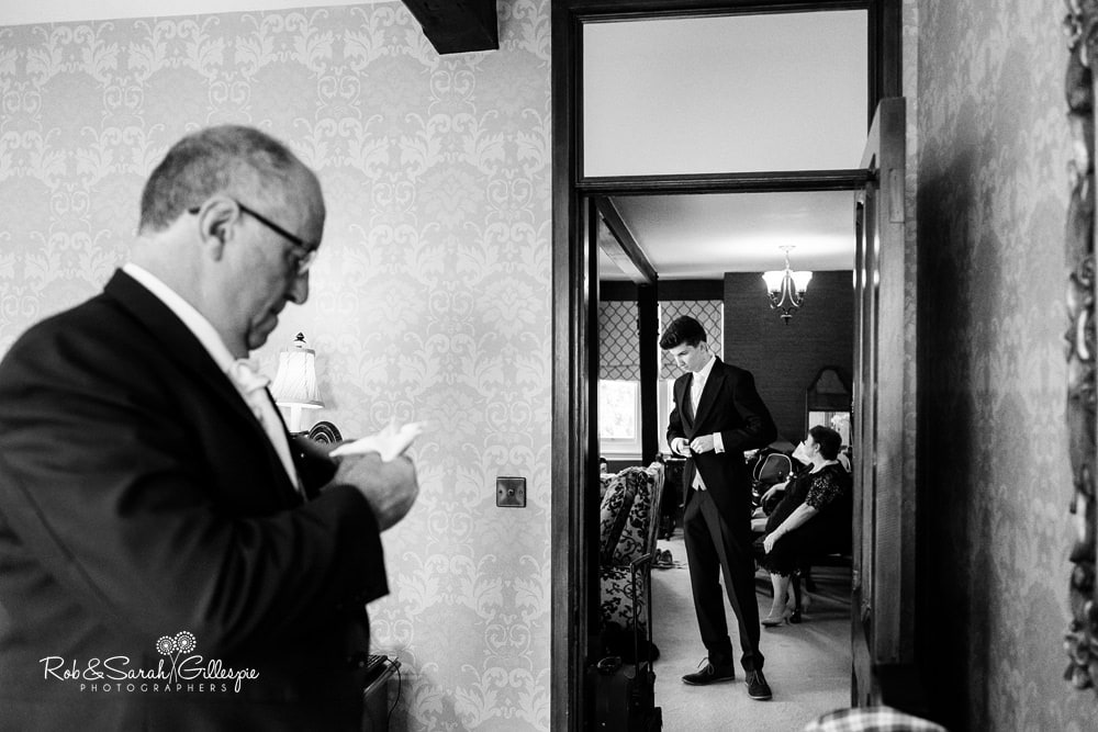 Groom and ushers get ready for wedding at Stanbrook Abbey