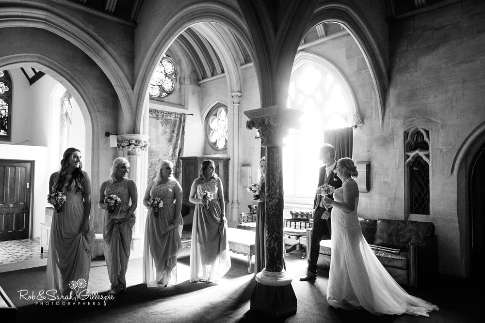 Bride and bridesmaids final moments before wedding ceremony at Stanbrook Abbey