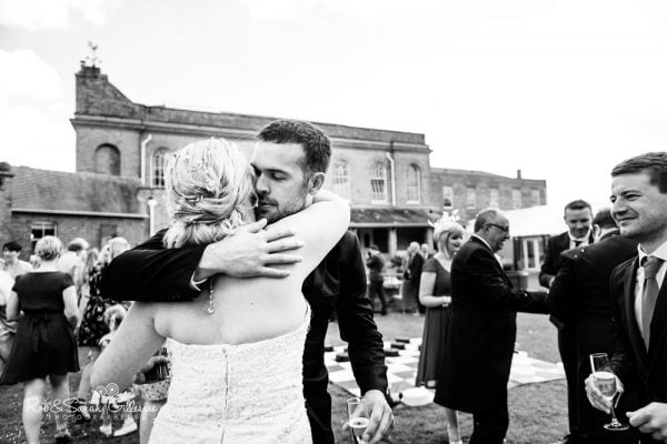 Hugs during recpetion at Stanbrook Abbey
