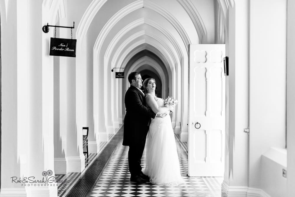 Bride and groom in cloisters at Stanbrook Abbey