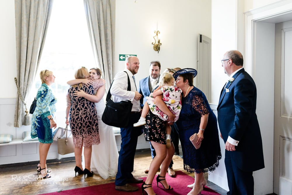 Bride and groom greet guests for wedding breakfast at Stanbrook Abbey
