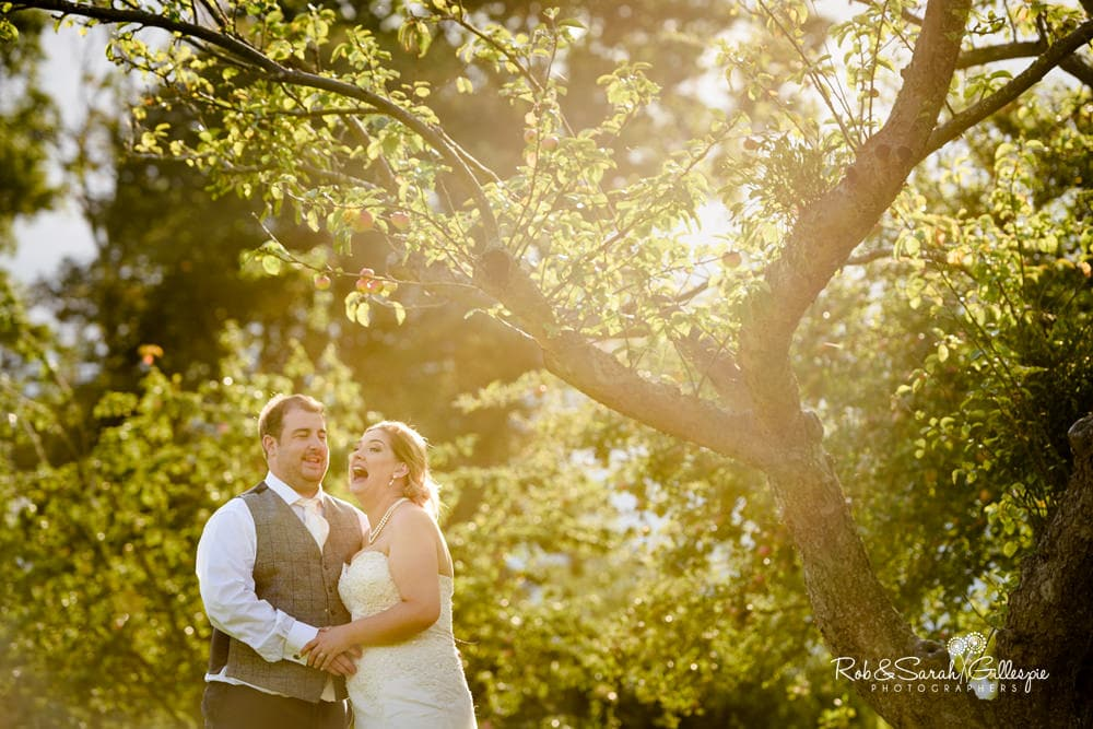 Bride and groom together in Stanbrook Abbey grounds
