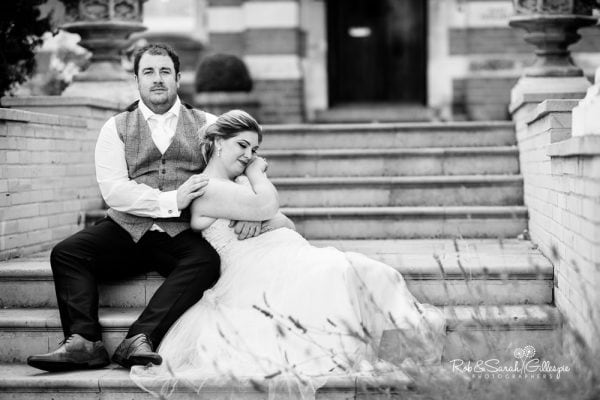 Bride and groom on steps at Stanbrook Abbey