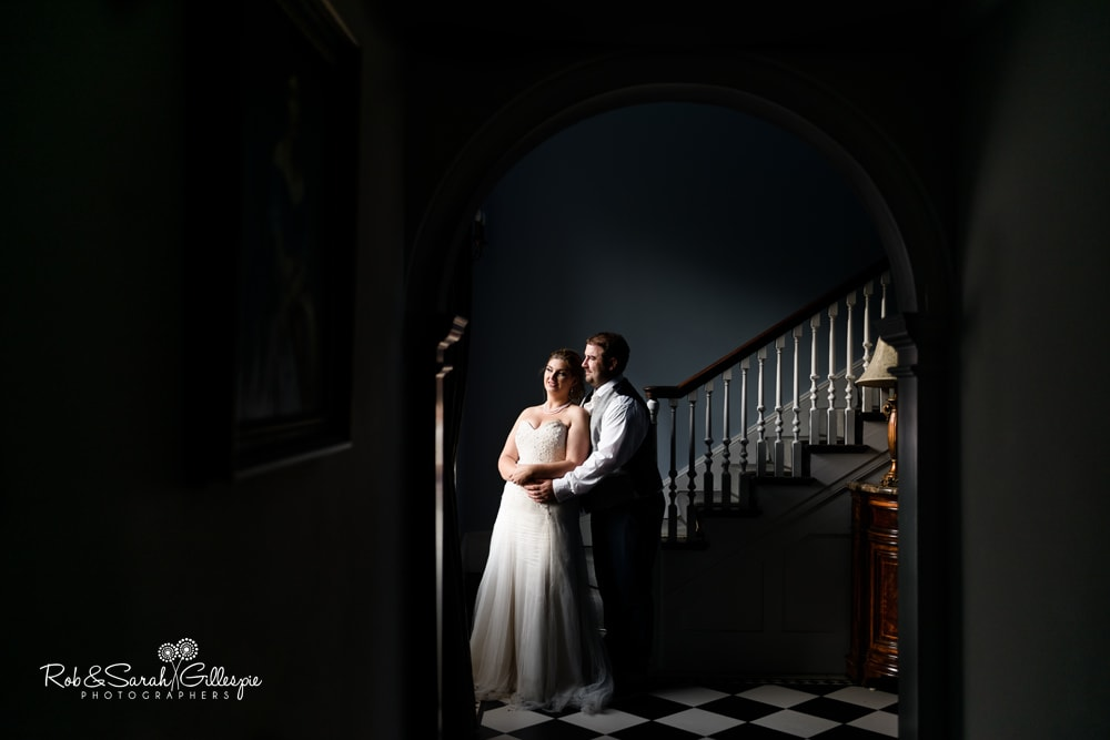 Bride and groom together in beautiful light at Stanbrook Abbey