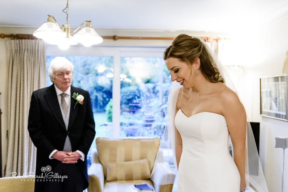 Bride's father sees his daughter in her wedding dress