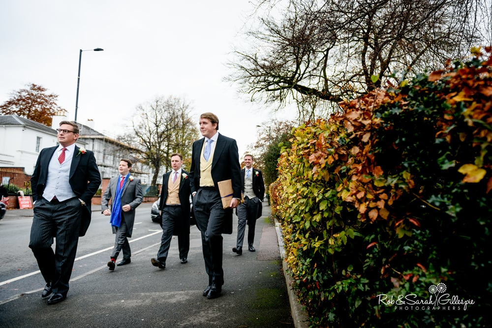 Groomsmen walk to Edgbaston Old Church for wedding