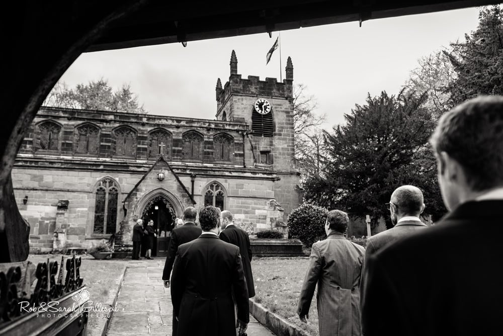 Groomsmen walk towards Edgbaston Old Church for wedding