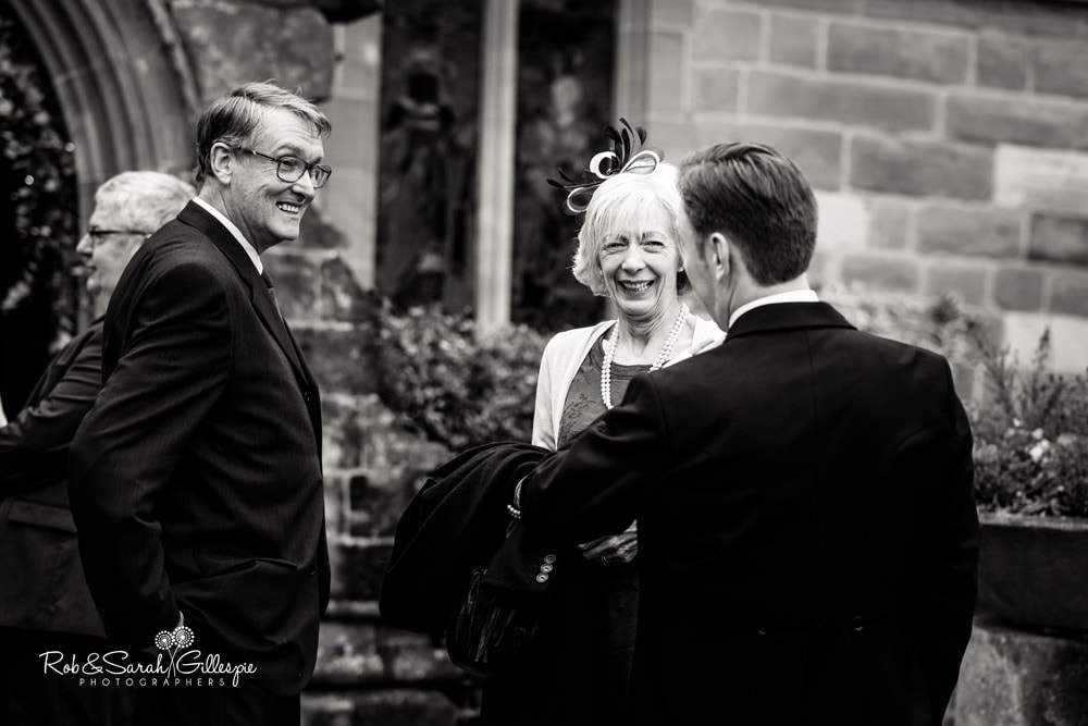 Grooms greets wedding guests at Edgbaston Old Church
