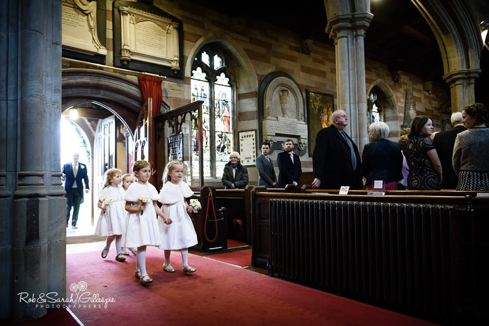 Flowergirls enter Edgbaston Old Church at start of wedding service