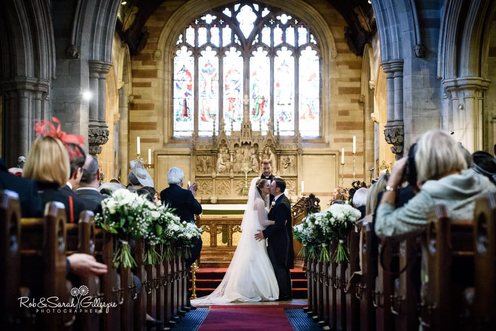 Bride and groom first kiss as husband and wife at Edgbaston Old Church
