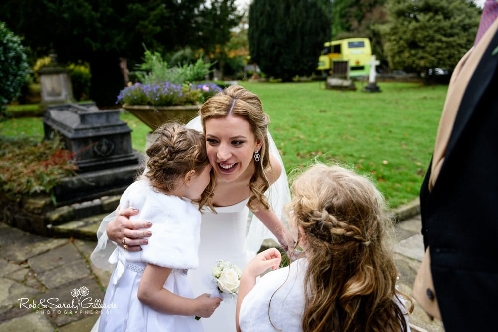Bride hugs flowergirls