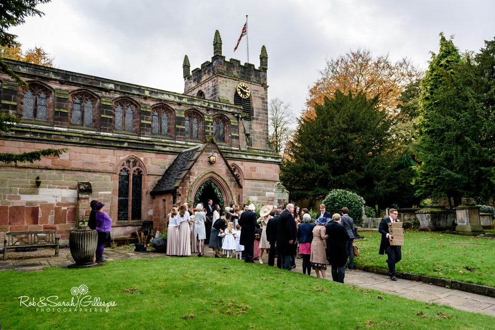 Wedding guests gather outside Edgbaston Old Church after service