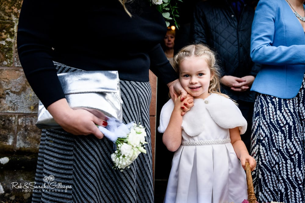 Flowergirl smiles for camera