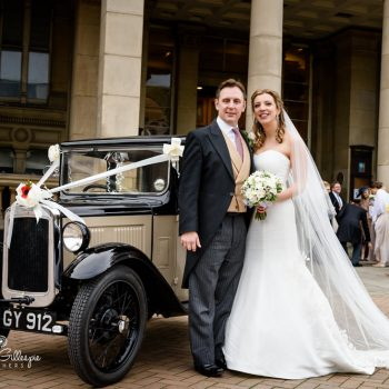 Bride and groom with old wedding car in Birmingham city centre