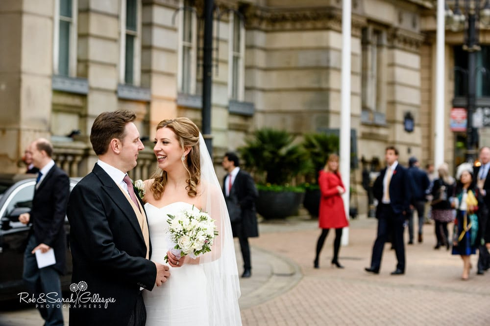 Bride and groom arrive at Birmingham Council House for wedding reception