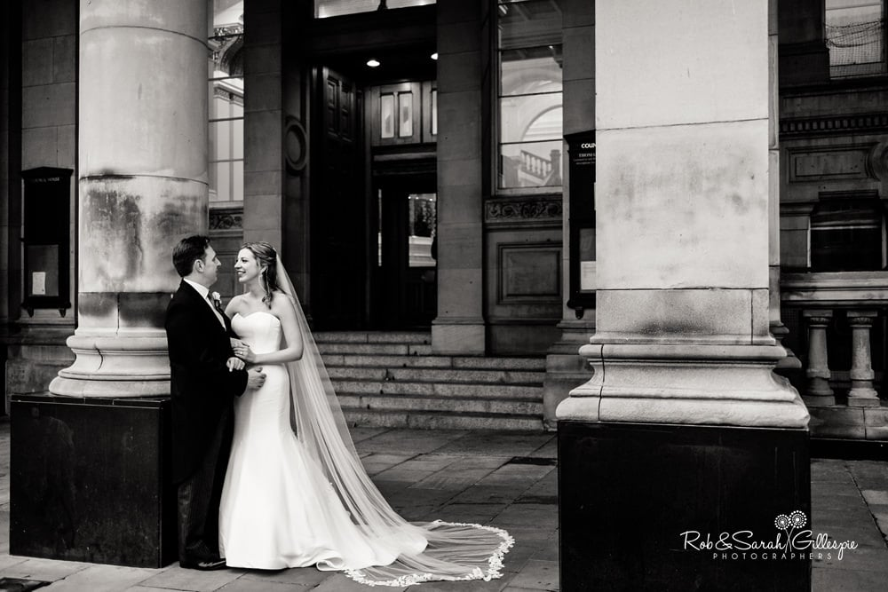 Bride and groom in front of Birmingham Council House entrnace