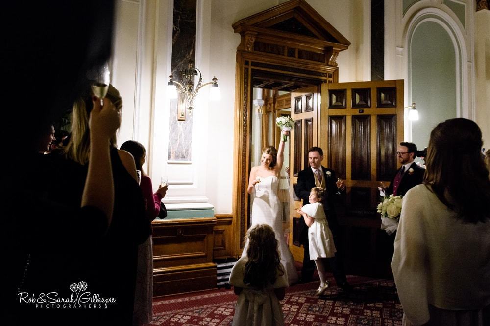 Bride and groom enter Banqueting Suite at Birmingham Council House for wedding reception
