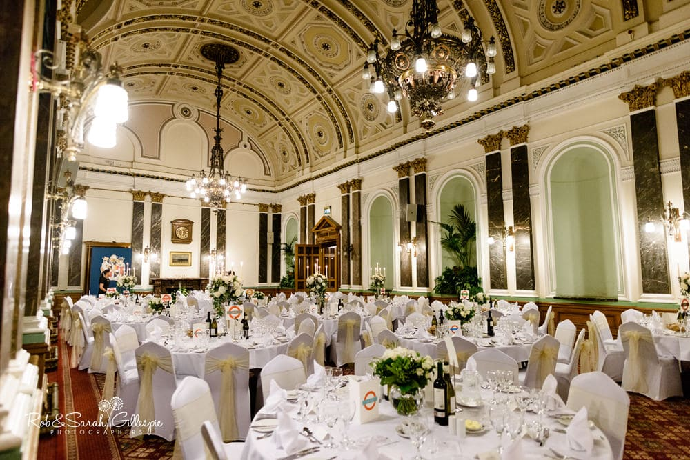 Banqueting Suite at Birmingham Council House set up ready for wedding reception, with round tables and decoration
