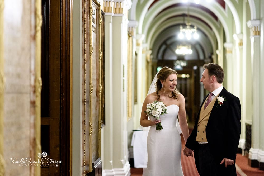 Bride and groom share a moment before thet enter for wedding breakfast in Banqueting Suite