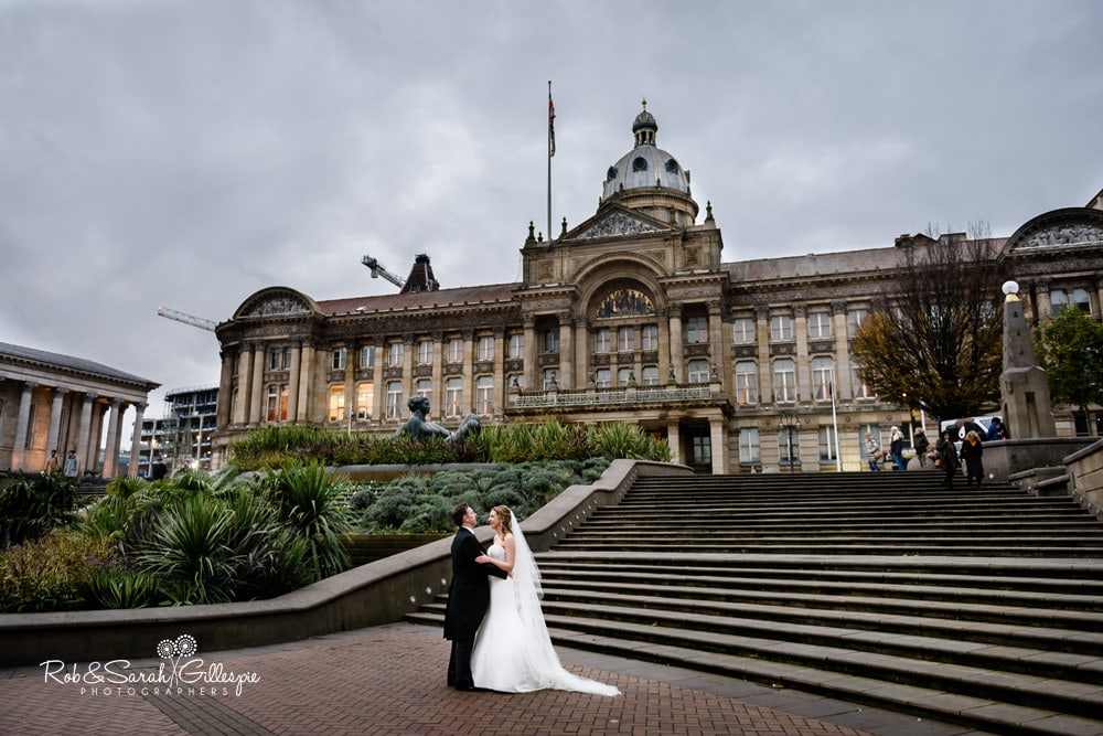 Bride and groom standing in front of Birmingham Council House