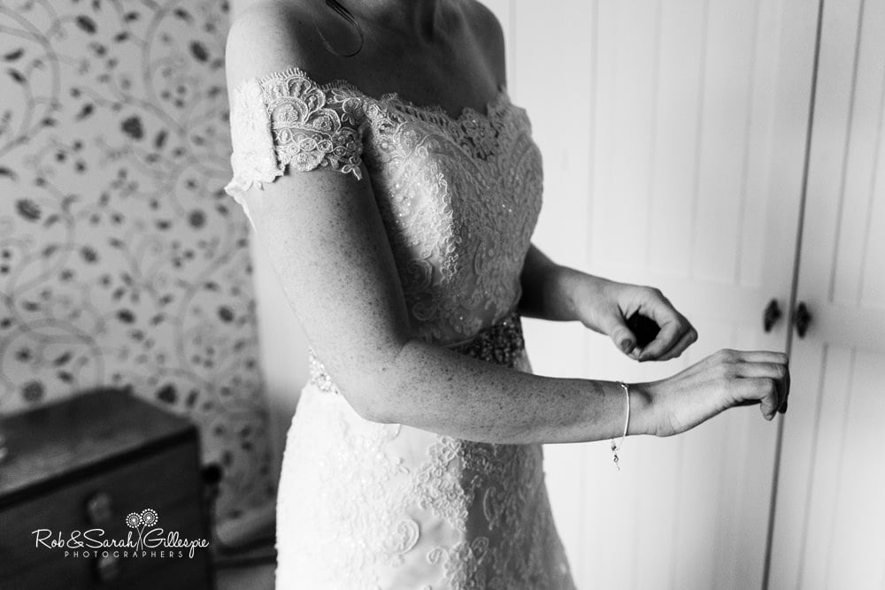 Bride adjusts bracelet while getting ready for wedding