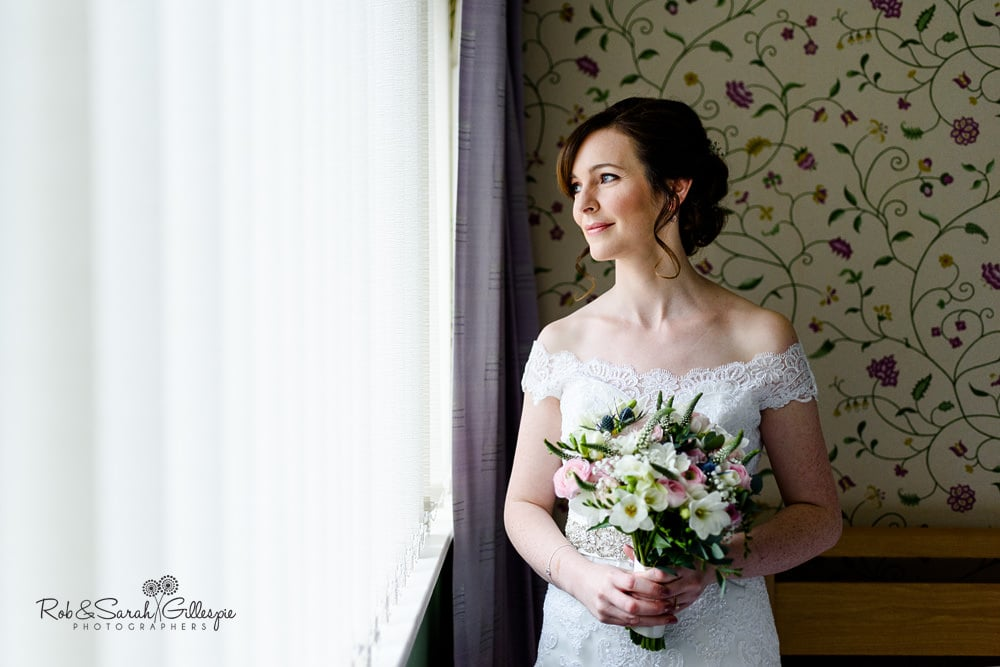 Portrait of bride in beautiful window light