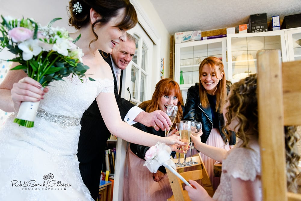 Bride and bridesmaids all raise a toast